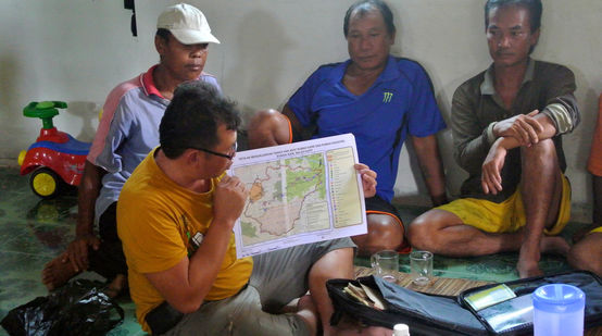 Matek Geram (SADIA) with map of illegal logging