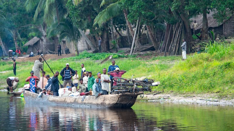 A fully loaded pirogue is underway on the Congo River