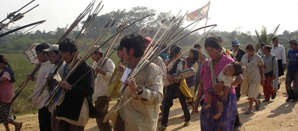 Bolivian Indians walking their protest march with arrow and bow in their hands