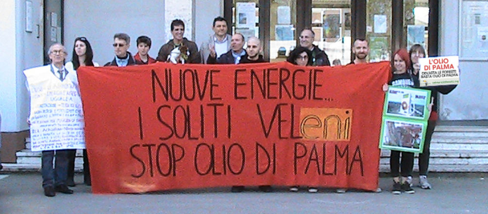 Environmentalists with their protest banners in front of the city hall of Marghera, Italy