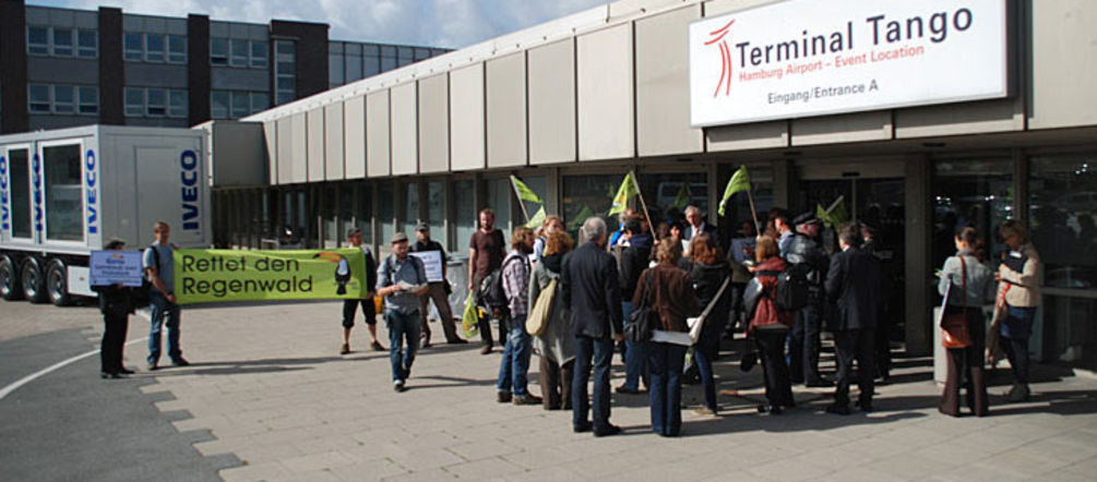 "Protesters standing infront of ""Terminal Tango"" at Hamburg Airport"