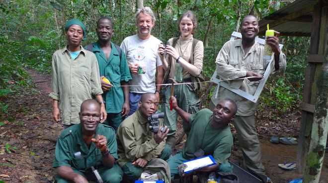 A group of researchers and helpers with their tools in the rainforest