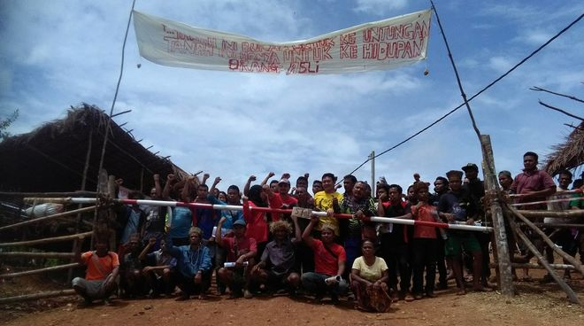 Indigenous people blocking a logging road in western Malaysia