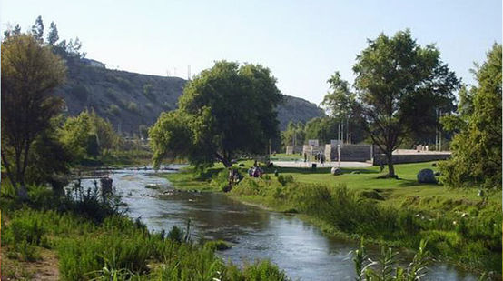 The fertile Huasco valley: a river flowing through green landscape