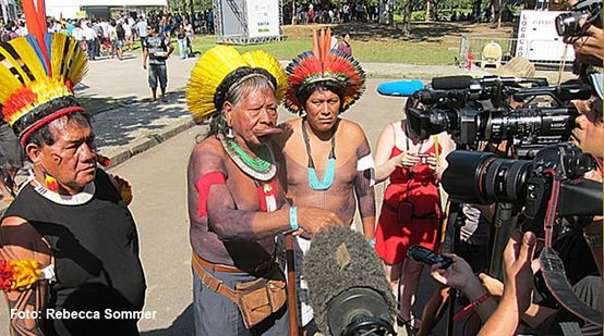 Chief Raoni with his feathered headdress and war paint gives an Interview