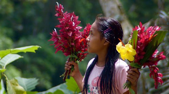 Kichwa girl with flowers in her hand in Sarayaku