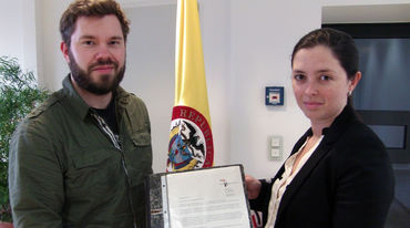 David Vollrath from Rainforest Rescue hands over the signatures to the diplomatic secretary