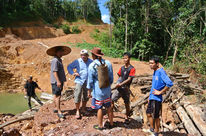 Matek (SADIA) with indigenous people at an illegal logging site
