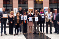Environmental activists hand over the signatures to members of the European Parliament